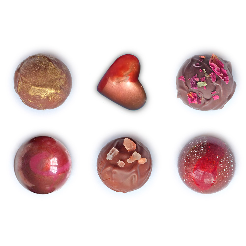 A selection of bitesize, handmade chocolates like you can find and make at Nenettes Chocolates