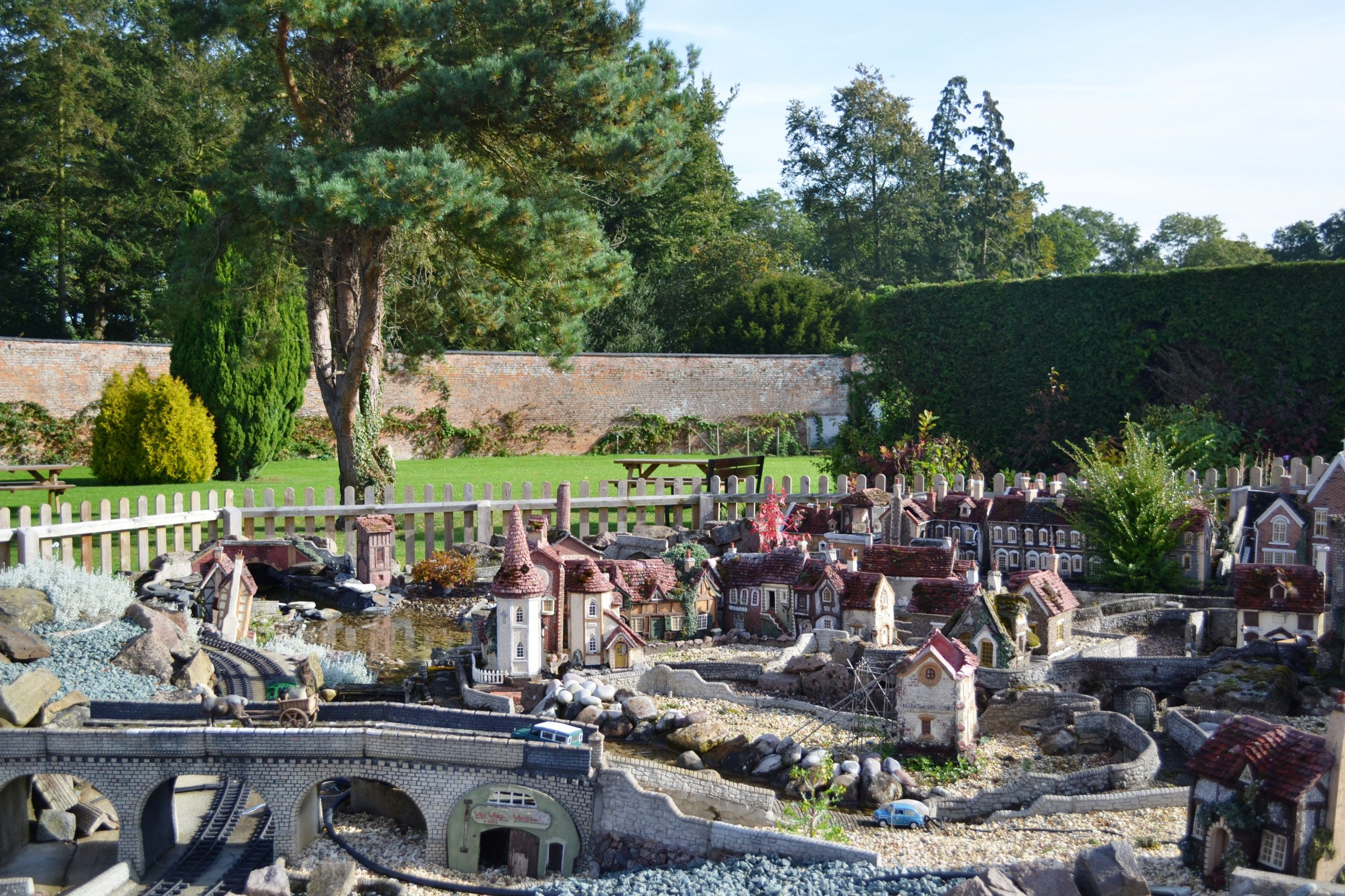 The garden at Wistow Rural Centre with a model village