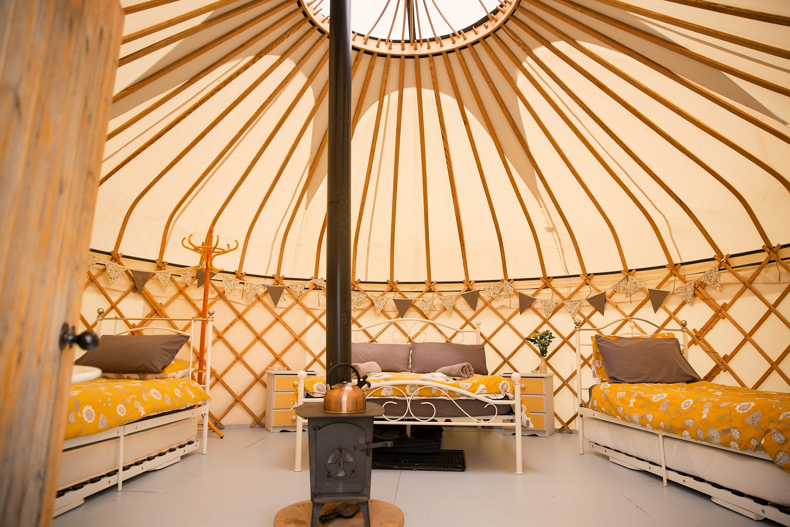The bright and cosy inside of one of the yurts at Country Bumpkin Yurts